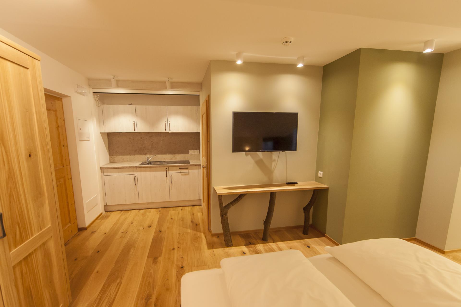 Zimmer latemar unterkunft rosengarten dolomiten hotel for A suite salon jupiter